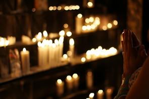 Praying at candles